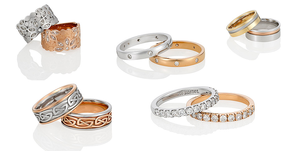 gold and silver rings with diamonds on white background