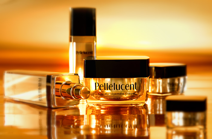 Pellelucent Product Range of cosmetics on gold background